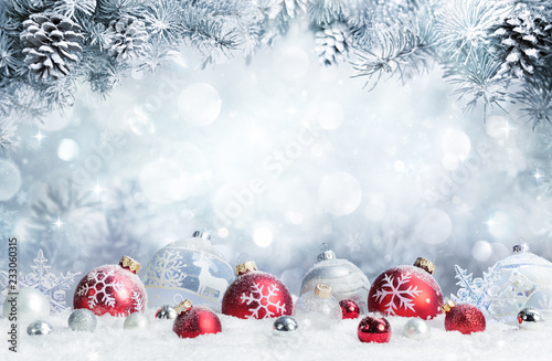 Fototapeta Merry Christmas - Baubles On Snow With Fir Branches