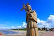 Ustka, Pomerania, Poland - Statue of Saint John of Nepomuk at the breakwater constructions at the Slupia river confluence into Baltic Sea