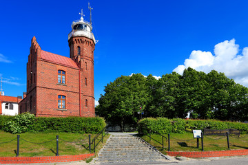 Ustka, Pomerania, Poland - Historic lighthouse building at the Baltic Sea shoreline and Slupia river in Ustka