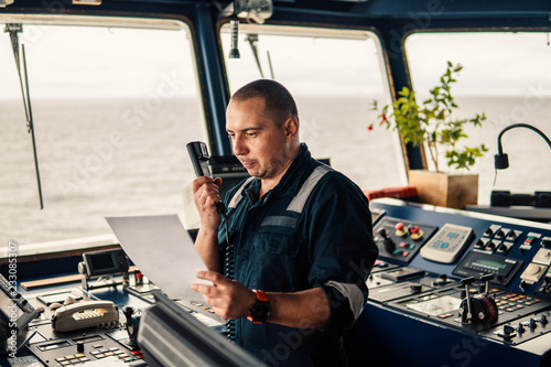 Cuadros en Lienzo Marine navigational officer is reporting by VHF radio during navigation watch
