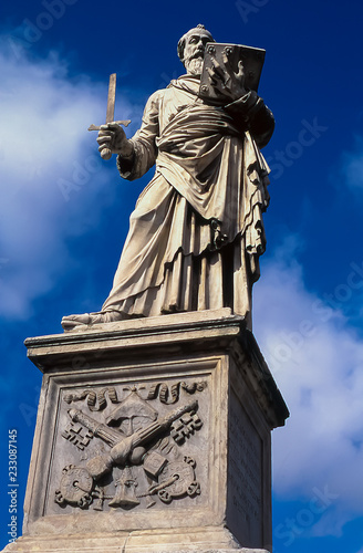 Fotografie, Obraz  Baroque statue by Gian Lorenzo Bernini of St Paul With Sword on the Pont Saint A