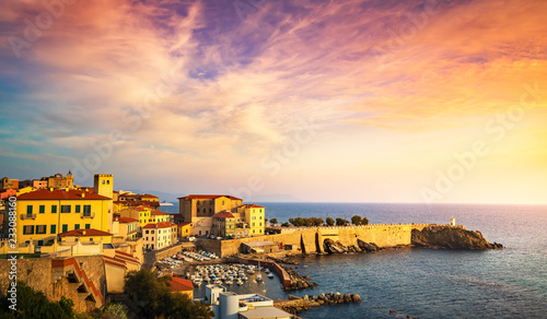 fototapeta na ścianę Sunset view of Piombino piazza bovio lighthouse. Tuscany Italy