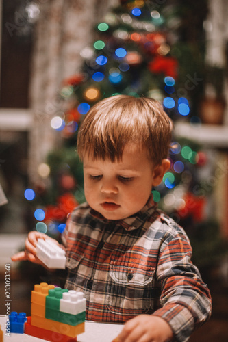 Fotografie, Obraz  Baby boy playing at home during Christmas