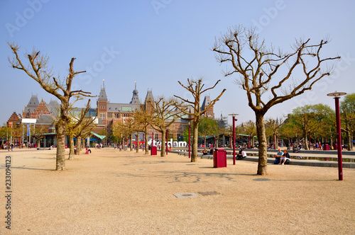 Foto op Canvas Barcelona Rijksmuseum naked bald trees and yellow sand in Amsterdam, Holla