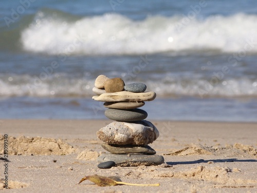 Rock Art Balance Zen On Sandy Beach With Waves In Background Buy