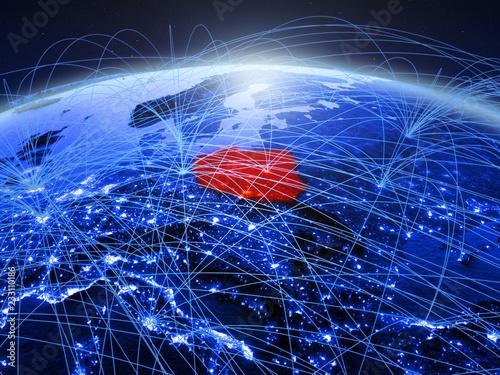 Polska na niebieskiej cyfrowej planecie Ziemia z międzynarodową siecią reprezentującą komunikację, podróże i połączenia.