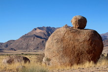 Large Round Rock On A Massive ...