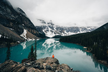 Person Sitting On Rock Overlooking Moraine Lake, Canada