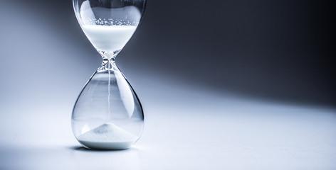 Modern hourglass in running time in studio lights