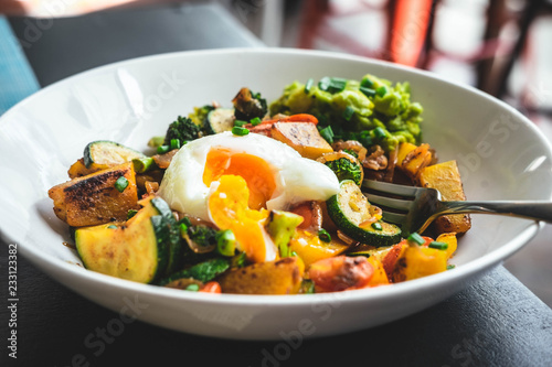 Cadres-photo bureau Nature Roasted veggies salad, pumpkin, zucchini, broccoli with avocado and poached egg. Healthy eating, food photography concept.
