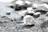 Fototapeta Kamienie - lump of silver or platinum on a stone floor