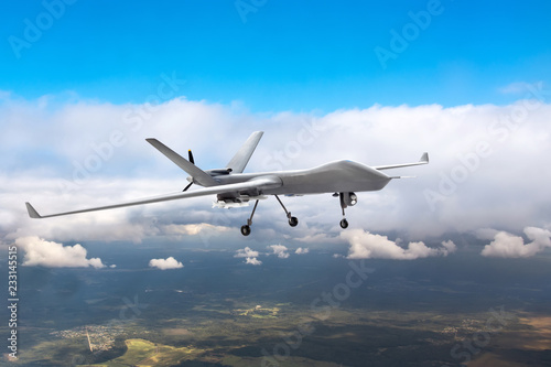 Patrolling unmanned aircraft in the sky above the terrain, fly tracking.