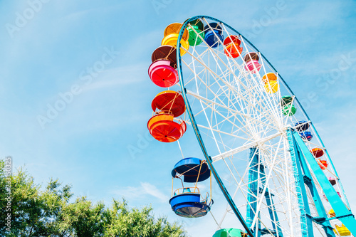 Poster Attraction parc Colorful ferris wheel at amusement park in Vladivostok, Russia