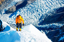 Climber Reaches The Summit Of ...