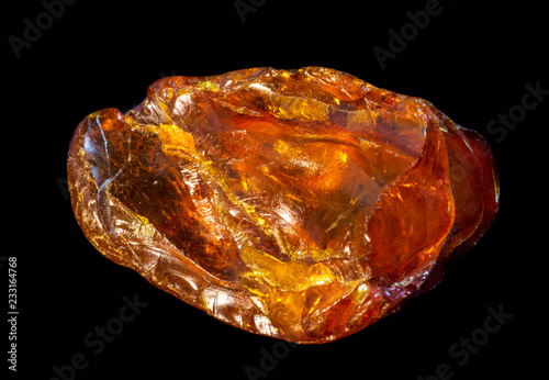 Papel de parede Natural piece of amber on a black background
