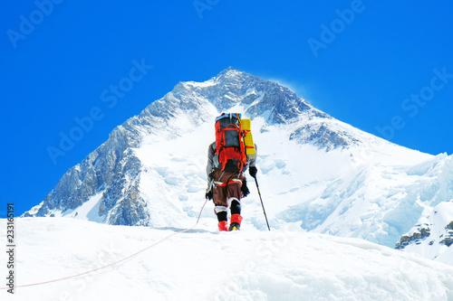 Vászonkép Climber reache the summit of mountain peak
