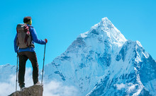 Hiker With Backpacks Reaches The Summit Of Mountain Peak. Success, Freedom And Happiness, Achievement In Mountains. Active Sport Concept.