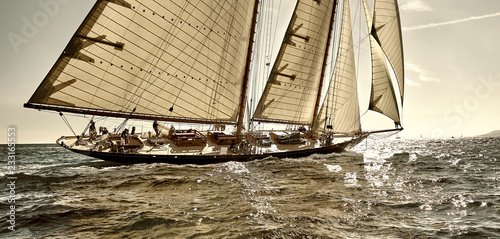 Canvas Prints Ship Sailboat under white sails at the regatta. Sailing yacht race