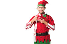 Smiling Man In Christmas Elf Costume Holding Cup Of Tea And Looking At Camera Isolated On White