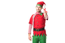 Smiling Man In Christmas Elf Costume Holding Wishlist Roll And Looking At Camera Isolated On White