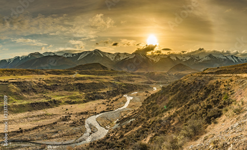 Fotografiet Cave Stream Scenic Reserve during sunset, South Island, New Zealand
