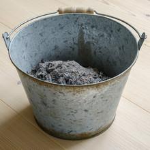 Ash In A Metal Bucket.