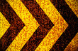 canvas print picture Warning sign yellow and black stripes as arrows painted over rusty metal plate as texture background. Concept for do not enter the area, caution, danger, hazard.