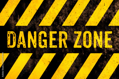 Valokuvatapetti Danger zone warning sign text with yellow and black stripes painted over concrete wall surface facade cement texture background