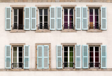 Eight Windows With Shutters Open And Closed On A Building In France