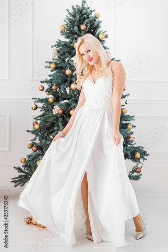 Portrait of beautiful blonde caucasian woman wearing white
