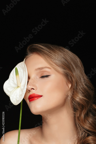 Fotografie, Obraz  Portrait of young attractive lady with wavy hair and red lips dreamily covering