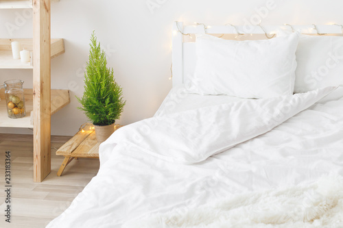 Fotografie, Obraz White cozy modern bedroom with holiday decoration