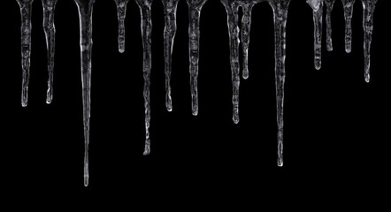 Close up of icicles isolated on black background