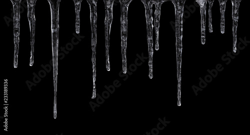 Fotografía Close up of icicles isolated on black background