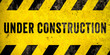 canvas print picture Under construction warning sign text with yellow black stripes painted over concrete wall cement facade as texture background banner. Concept do not enter area, caution, danger, construction site.