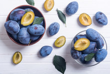 Fresh Plums In Bowl On Wooden ...
