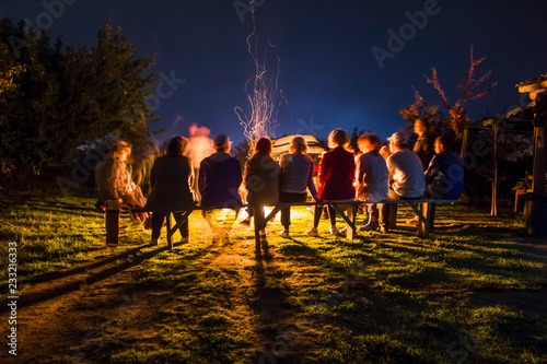 Obraz People rest near a bonfire on the nigt. long exposure - fototapety do salonu