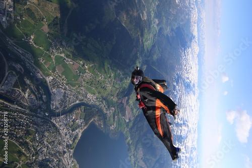 Fototapeta  Wingsuti skydiving over Norway