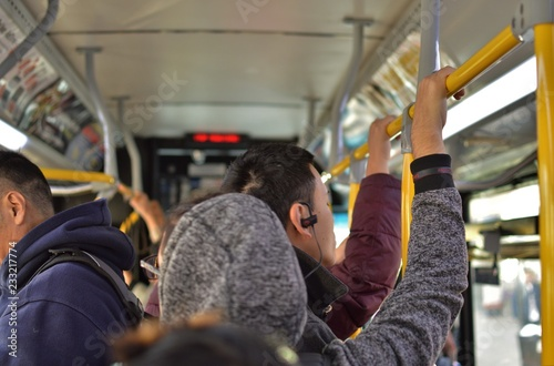 Obraz Worker People on Crowded MTA New York City Bus Transit Frustrated Passengers Delayed Service - fototapety do salonu