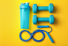 Flat Lay Composition With Jump Rope On Color Background