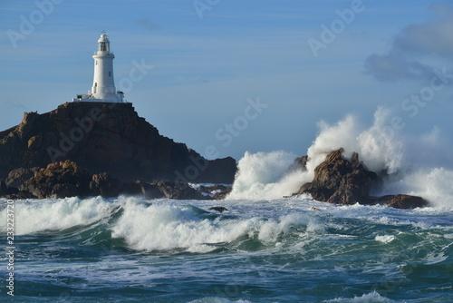 Montage in der Fensternische Leuchtturm La Corbiere lighthouse, Jersey, U.K. Coastal landmark in Autumn.
