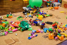 Childrens Toys On The Carpet. Bardak In The Childrens Room.