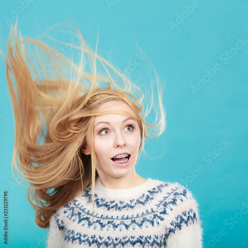 Fotografering Crazy blonde woman with windblown blonde hair