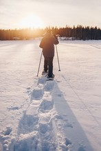 Man In Snowshoes Is Walking Wi...