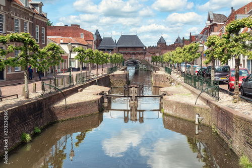 The canal Eem with in the background the medieval gate The Koppelpoort in the Du Wallpaper Mural