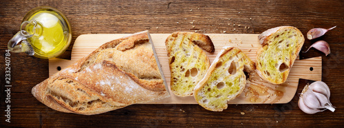 Fototapeta Bruschetta. Toasted bread with garlic and extra virgin olive oil. Top view obraz