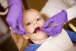 Little Girl at Dentist Getting Teeth Cleaned