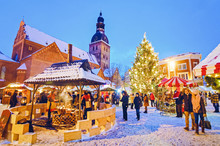 People Enjoy Christmas Market Riga