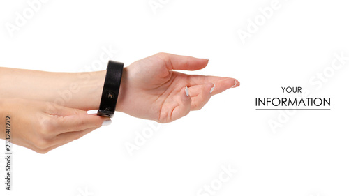 Fotografía Leather brown bracelet in hand pattern on white background isolation