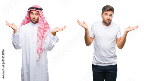 Fotografie, Tablou Collage of handsome young man and arab man over isolated background clueless and confused expression with arms and hands raised